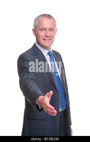 A mature businessman offering to shake your hand isolated on a white background - Stock Photo