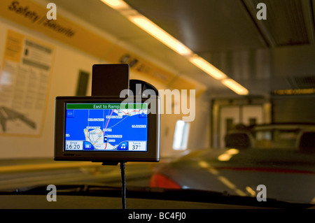 Boarding 'The Shuttle' cross channel Eurotunnel vehicle train with GPS satellite navigation screen showing position - Stock Photo