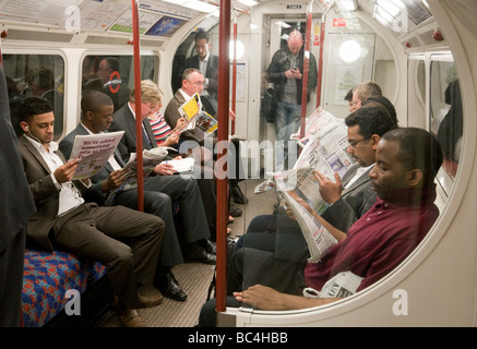 People sitting in the interior of a carriage on a London Underground train, london,  UK - Stock Photo
