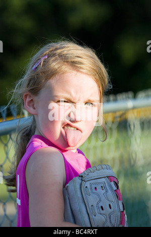 Girl sticking making funny face - Stock Photo