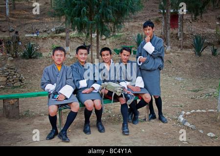 Young Novice Monks students in grey unifiorms outside Punakha Dzong monastery . Horizontal  91587 Bhutan-Punakha - Stock Photo