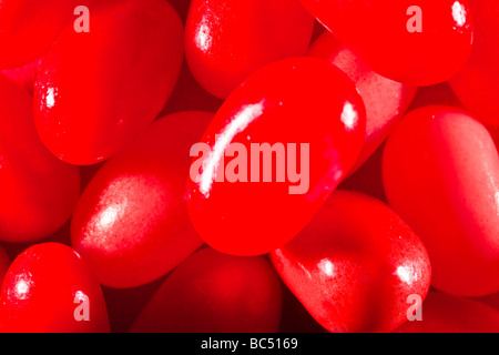 Red jelly beans captured in 16 bit and provided in Adobe1998 color space to hold difficult red tones - Stock Photo