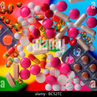 Coloured pills medicine packshot drug medication tablets and pills - Stock Photo