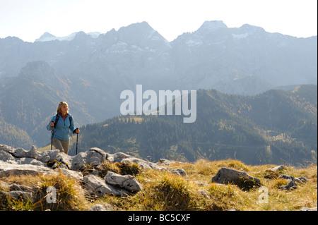 Austria, Karwendel, Rissbachtal, Woman Nordic Walking - Stock Photo