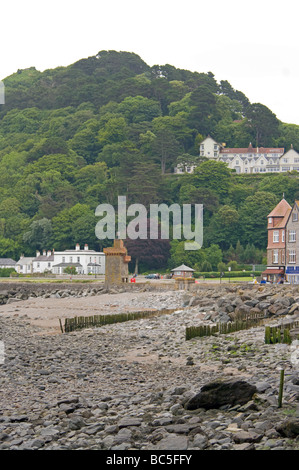 Lynmouth Rock Strewn Seafront and The Overlooking Tree Covered Hillsides North Devon England - Stock Photo