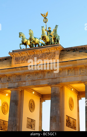 Shot at dusk of the Brandenburg Gate (Brandenburger Tor) in Berlin, Germany, with the colmns and quadriga, a chariot - Stock Photo