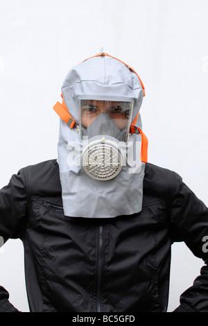 Woman wearing gas mask, portrait - Stock Photo