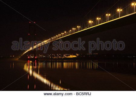 Humber Bridge  Night View reflecting street lighting in a calm river - Stock Photo