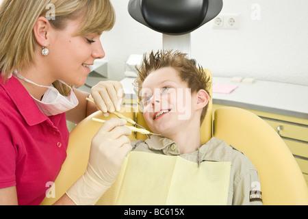 Boy at dentist - Stock Photo