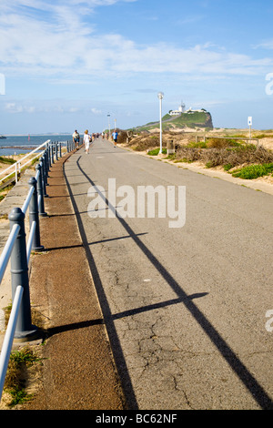 Walking out to Nobbys Head along the path next to the Beach, Newcastle, New South Wales. Australia - Stock Photo