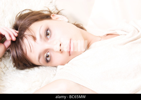 Resting woman portrait Bright lighting without shadows - Stock Photo