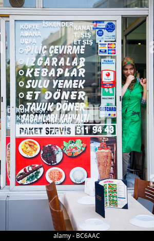 Turkey , Istanbul , pretty young girl in hijab waits for customers by typical Turkish fast food cafe restaurant - Stock Photo