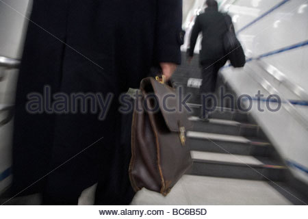 businessman rushing up the stairs - Stock Photo