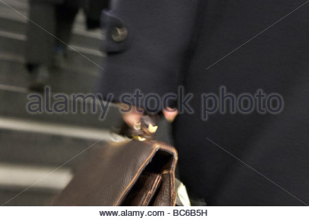 business people going up stairs - Stock Photo