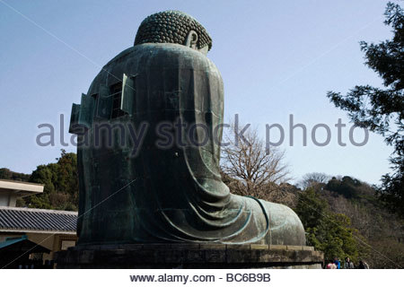 The Great Buddha of Kamakura is a bronze statue of Amida Buddha that is located on the grounds of the Kotokuin Temple - Stock Photo