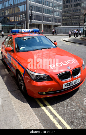 Red Police Chase BMW - Stock Photo