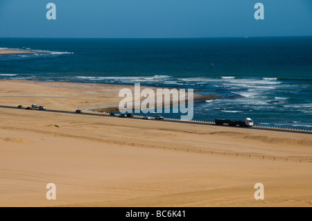 the highway along the Skeleton Coast outside of Walvis Bay in Namibia - Stock Photo
