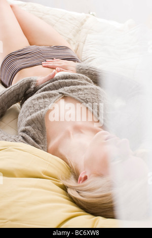 young woman with stomach ache - Stock Photo