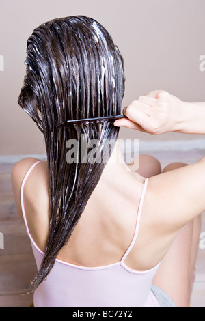 woman spread hair conditioner - Stock Photo