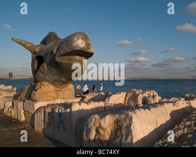 Jonah and the Whale sculpture at the port of the old city of Akko or Acre, northern Israel - Stock Photo