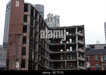 exposed interior of a building being torn down in boston massachusetts. tearing down old building to make room for - Stock Photo