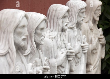 A row of statues of Jesus Christ sculpted out of pure white Carrara marble in Nicoli Sculpture Studios - Stock Photo