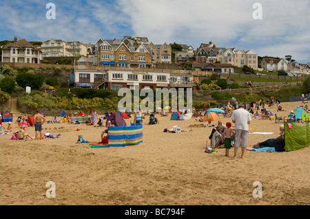 Holidaymakers On The Beach at Woolacombe Bay North Devon With The Overlooking Town - Stock Photo