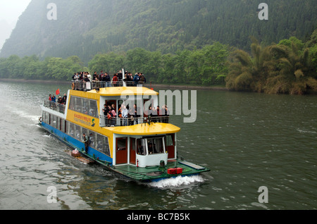 Tourists cruising on the Li River between Guilin and Yangshuo Guangxi China - Stock Photo