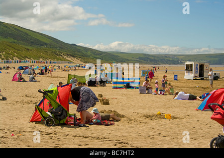 Holidaymakers On The Seaside Beach at Woolacombe Bay North Devon England uk - Stock Photo