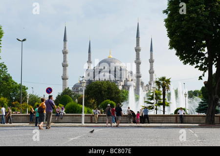 Turkey , Istanbul , Sultanahmet , The Blue Mosque or Sultan Ahmet Camii , towers over gardens & fountain , tourists - Stock Photo