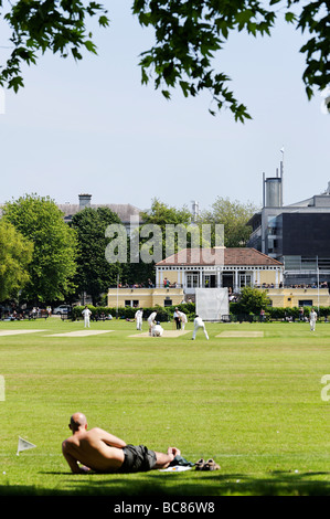Spectator watching a match during lunch break at Trinity College cricket club grounds in central Dublin Republic - Stock Photo