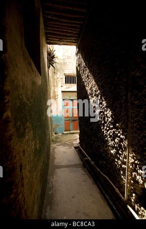 Narrow street in Lamu town - Lamu Island, Kenya - Stock Photo