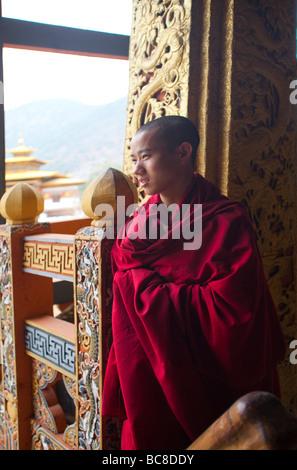 Young Novice monk student in red habit at Punakha Dzong Monastery  .Vertical   91656 Bhutan-Punakha - Stock Photo