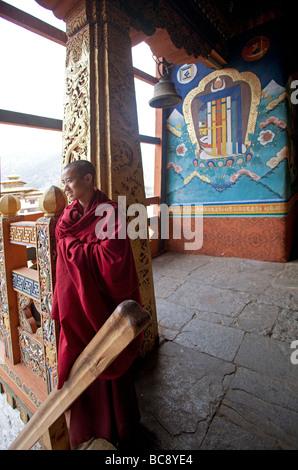 Young Novice monk student in red habit at Punakha Dzong Monastery  .Vertical   91657 Bhutan-Punakha - Stock Photo