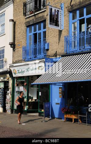 Street Scene in Kings Parade, featuring the Primavera art gallery and Jim Garrahy's fudge kitchen,  Cambridge England - Stock Photo