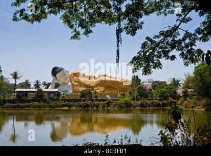 Big statue of the lying Buddha in Bago, Myanmar - Stock Photo