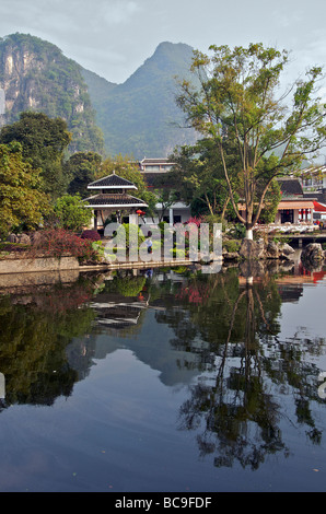 Reflections in pond Yangshuo Guangxi China - Stock Photo