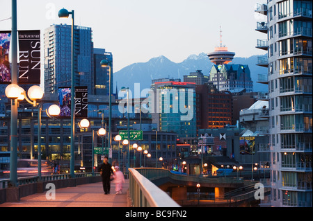 snowy mountains behind downtown and Harbour Centre Tower Vancouver British Columbia Canada - Stock Photo
