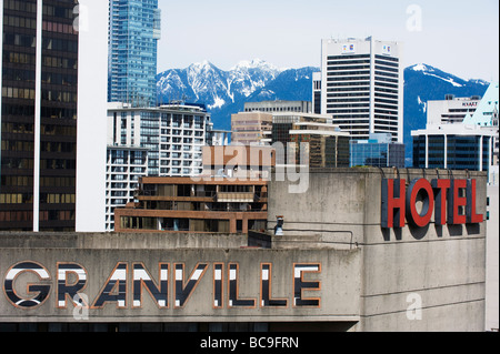 snowy mountains behind downtown Vancouver British Columbia Canada - Stock Photo