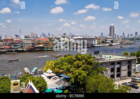 Panoramic view over the city centre of Bangkok, Thailand, along the Chao Praya river - Stock Photo