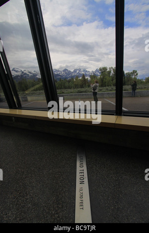 floor plaque pointing to Grand Teton at Craig Thomas Discovery & Visitor Center in Grand Teton National Park, Wyoming - Stock Photo