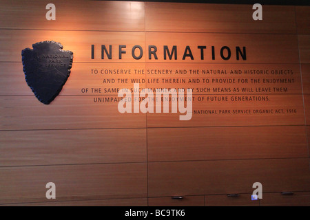 Inscription behind the main ranger desk at Craig Thomas Discovery & Visitor Center - Stock Photo