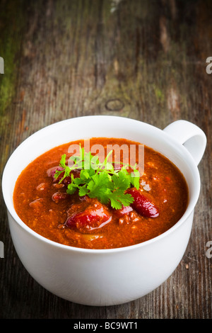 A cup of chili con carne with coriander - Stock Photo
