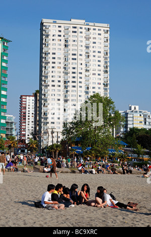 English bay beach Westend young people relaxing Promenade Vancouver City Canada North America - Stock Photo