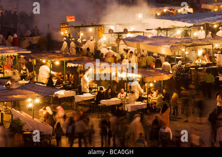 Night time in the bustling market of Jemaa el Fna Marrakesh - Stock Photo