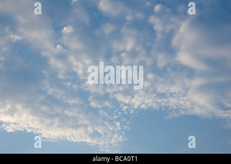 Undulating and dappled  cloud underlit by sunlight. - Stock Photo