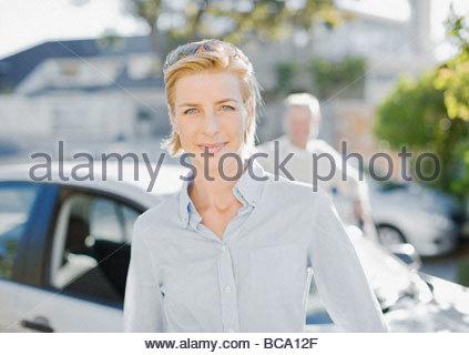 Couple standing near car - Stock Photo