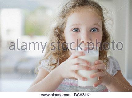 Girl drinking glass of milk - Stock Photo