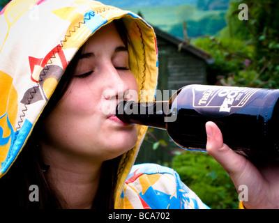 teenager drinking beer - Stock Photo