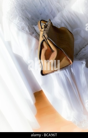 Travelling leather bag in timeless white interior setting - Stock Photo